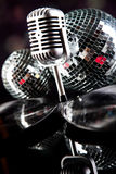 Microphone with disco balls, music saturated concept Stock Photography