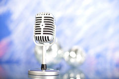 Microphone with disco balls, music saturated concept Royalty Free Stock Image