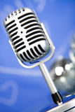 Microphone with disco balls, music saturated concept Royalty Free Stock Photography
