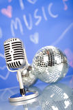 Microphone with disco balls, music saturated concept Stock Photos