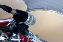 Microphone for drum set-up on wall background Royalty Free Stock Photo