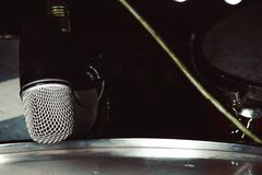 MIC the drums close-up. Microphone for drum set-up on wall background stock photos