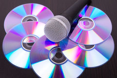 Microphone on dvd disc Stock Images