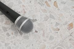 Microphone dynamic on floor marble polished stone background Royalty Free Stock Photography