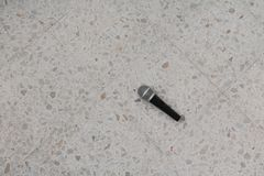 Microphone dynamic on floor marble polished stone background Royalty Free Stock Photos