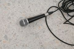 Microphone dynamic on floor marble polished stone background Stock Photo
