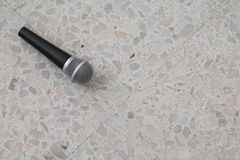 Microphone dynamic on floor marble polished stone background Royalty Free Stock Image