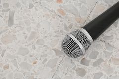 Microphone dynamic on floor marble polished stone background Royalty Free Stock Images