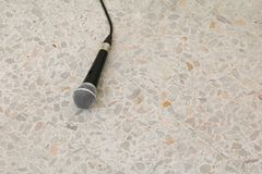 Microphone dynamic on floor marble polished stone background.  Stock Photos