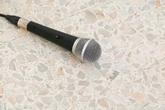 Microphone dynamic on floor marble polished stone background.  Royalty Free Stock Images