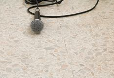 Microphone dynamic on floor marble polished stone background.  Stock Images