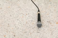 Microphone dynamic on floor marble polished stone background.  Royalty Free Stock Image