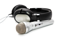 Microphone and ear-phones Royalty Free Stock Photography