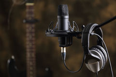 Microphone, earphones and electric guitar Royalty Free Stock Photography