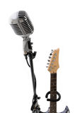 Microphone and electric guitar Stock Photography