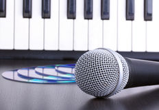 Microphone, electronic keyboardand cd discs Royalty Free Stock Images