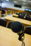 Microphone in empty conference room . Royalty Free Stock Photography