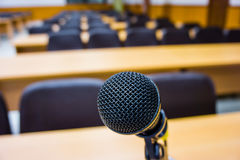 Microphone in empty conference room . Stock Photos