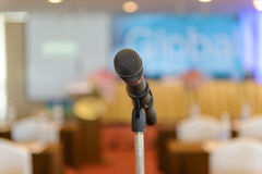 Microphone in empty room Stock Photography