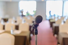 Microphone in empty room Stock Photo