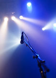 Microphone on empty stage waiting for a voice Royalty Free Stock Image