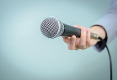 Microphone. Female with microphone, close up royalty free stock image