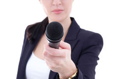 Microphone in female  reporter's hand over white. Background Stock Image