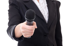 Microphone in female reporter's hand over white. Background Royalty Free Stock Images