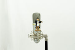 Microphone with figure violinist Stock Photos