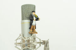 Microphone with figure violinist Stock Images