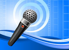 Microphone on film reel background Royalty Free Stock Image