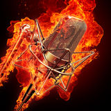 Microphone & fire. Professional studio microphone and fire Royalty Free Stock Photo