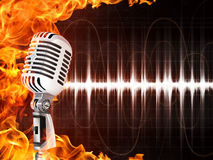 Microphone on Fire Background. Old Microphone on Fire Background. Computer Graphics Royalty Free Stock Photos