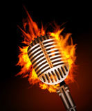 Microphone in Fire. On Black Background Royalty Free Stock Photo