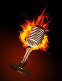 Microphone in Fire. On Black Background Stock Photo