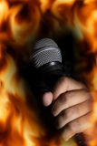 Microphone with fire flame screen. Royalty Free Stock Images