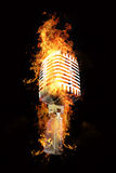 Microphone in flames Royalty Free Stock Photos