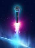 Microphone. Floating in the sky royalty free stock image