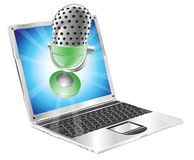 Microphone flying out of laptop screen concept. A microphone flying out of laptop screen. Concept for anything relating to online or computer recordings or music Royalty Free Stock Photos