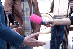 Microphone in focus. Press or media interview. Royalty Free Stock Photo