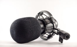Microphone in front of a white background Royalty Free Stock Images