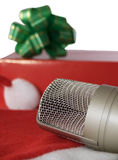 Microphone And Gift. A microphone and gift with white background Royalty Free Stock Photos
