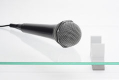 Microphone on the glass table. Microphone isolated on the glass table Stock Images