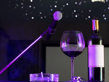 Microphone and a glass of wine. Royalty Free Stock Images