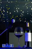 Microphone and a glass of wine. Stock Image