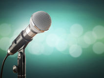 Microphone on the green abstract background. Royalty Free Stock Photo