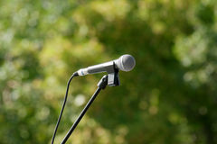 Microphone on green background. Microphone with stanchion on green background Royalty Free Stock Images