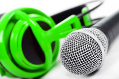 Microphone and green headphones Stock Image