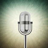 Microphone on green Royalty Free Stock Image