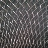 Microphone grid. Background of twisted steel wire. Patterned texture of metal. Macro shooting with shallow depth of field. Close-. Microphone grid. Close-up royalty free stock image